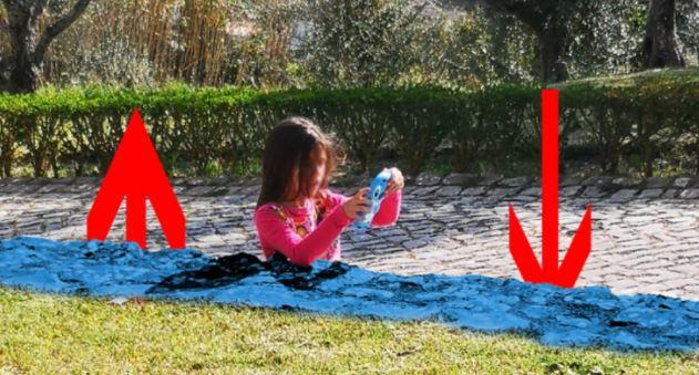 Foto com criança 'cimentada' em rua viraliza; você consegue decifrar?